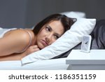 insomniac woman bored looking... | Shutterstock . vector #1186351159