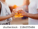 couple cheering with beer.... | Shutterstock . vector #1186355686