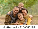 portrait of family of four in... | Shutterstock . vector #1186385173