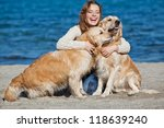Stock photo beautiful girl with her dog near sea 118639240