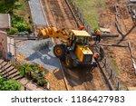 yellow loader is unloading... | Shutterstock . vector #1186427983