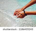 female hands against the blue... | Shutterstock . vector #1186435243