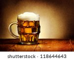 beer mug on rustic wooden table | Shutterstock . vector #118644643