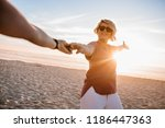 smiling young woman wearing... | Shutterstock . vector #1186447363