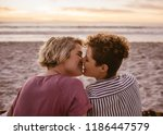 rearview of a romantic young... | Shutterstock . vector #1186447579