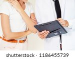 male doctor and female patient...   Shutterstock . vector #1186455739
