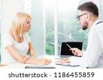 male doctor is talking to...   Shutterstock . vector #1186455859