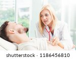 woman doctor is talking and...   Shutterstock . vector #1186456810