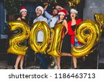 celebrating new year party.... | Shutterstock . vector #1186463713