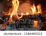 burning firewood in the... | Shutterstock . vector #1186483213