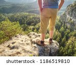 hiker man stays on the mountain ... | Shutterstock . vector #1186519810