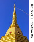 Thai Buddhist pagoda at Naka temple with blue sky background, Phuket province, Southern of Thailand - stock photo