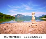 pyramid of flat stones on a... | Shutterstock . vector #1186520896