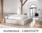 contemporary bedroom with white ... | Shutterstock . vector #1186551079