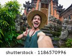 handsome man taking a selfie on ... | Shutterstock . vector #1186570996