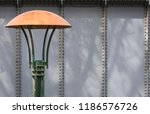 a green lamp post with a bronze ... | Shutterstock . vector #1186576726