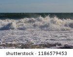 frothy foaming white backwash... | Shutterstock . vector #1186579453