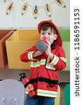 boy playing as fireman police... | Shutterstock . vector #1186591153