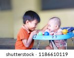a little brother playful and... | Shutterstock . vector #1186610119