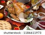 carving roasted pepper turkey...   Shutterstock . vector #1186611973