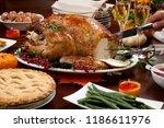 carving roasted pepper turkey... | Shutterstock . vector #1186611976