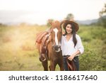 young woman with her horse in... | Shutterstock . vector #1186617640