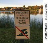 sign at park  irrigated with... | Shutterstock . vector #1186629289