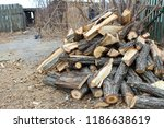 a pile of stacked firewood in... | Shutterstock . vector #1186638619