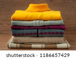 a pile of warm clothes for the... | Shutterstock . vector #1186657429