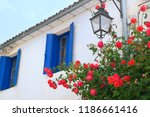 red roses in street with blue... | Shutterstock . vector #1186661416