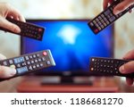many hands with tv remote... | Shutterstock . vector #1186681270