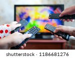 many hands with tv remote... | Shutterstock . vector #1186681276