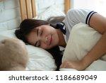 woman sleeping in bedroom at... | Shutterstock . vector #1186689049