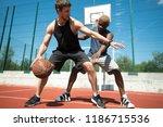 full length action shot  of two ... | Shutterstock . vector #1186715536