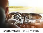 driving a car, a man with a beard sitting behind the wheel of a car and holding the wheel - stock photo