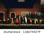 group of kids with halloween... | Shutterstock . vector #1186744279