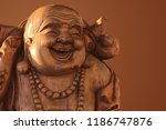 hotei or the laughing buddha is ... | Shutterstock . vector #1186747876