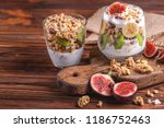 glass of homemade granola with... | Shutterstock . vector #1186752463