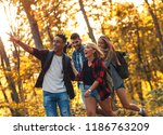 group of four friends hiking... | Shutterstock . vector #1186763209