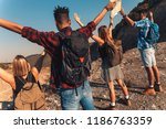 group of four friends hiking... | Shutterstock . vector #1186763359