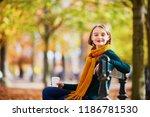 happy young girl in yellow... | Shutterstock . vector #1186781530