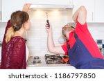electrician installing new... | Shutterstock . vector #1186797850