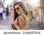 attractive brunette woman in... | Shutterstock . vector #1186857016