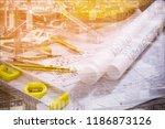 worker wearing workwear and... | Shutterstock . vector #1186873126
