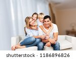 beautiful smiling family... | Shutterstock . vector #1186896826