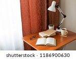 open book  lamp and cup of... | Shutterstock . vector #1186900630