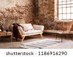 modern armchair next to grey... | Shutterstock . vector #1186916290