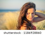 outdoor portrait of attractive... | Shutterstock . vector #1186928860