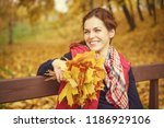 young beautiful woman in autumn ... | Shutterstock . vector #1186929106