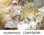a man in a cassock spends a... | Shutterstock . vector #1186938289